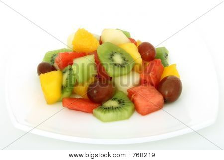 Fruit salad coctail on a plate