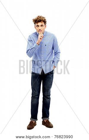 Young man making silence gesture, shhhhh!!