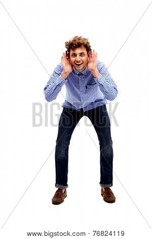 Full length portrait of a young man trying to hear something