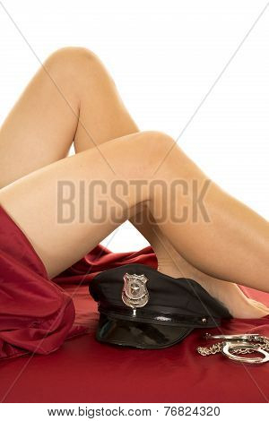 Woman Legs And Red Sheet Police Hat Below Knee Close