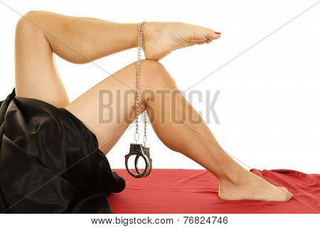 Woman Legs With Handcuffs On Foot Black Sheet