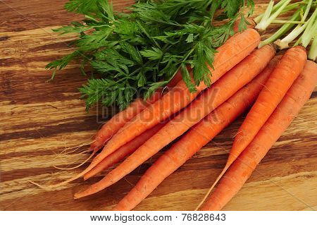 Extreme close-up image of  carrots placed on cutting board