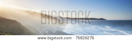 Amazing Panorama of Headland and Sea Fog at Sunrise.