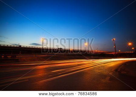 Beautiful Blue Dusky Sky Peak Of Twilight Time And Light Painting On Asphalt Road By Vehicle Moving