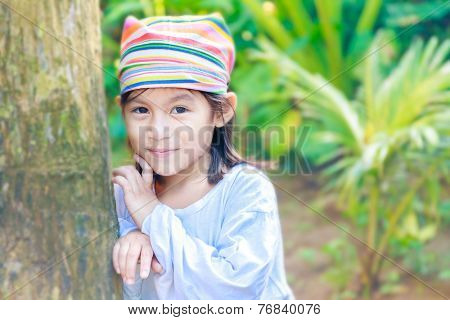 young beautiful child girl in traditional clothes on natural background, Philippines, Malay, Panay