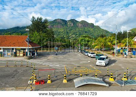 MAHE, SEYCHELLES - 21 OCTOBER 2014 - Line of taxis waiting at the quayside at Victoria harbour, Mahe, Seychelles to provide transport to passengers disembarking from the tour boats on 21 October 2014