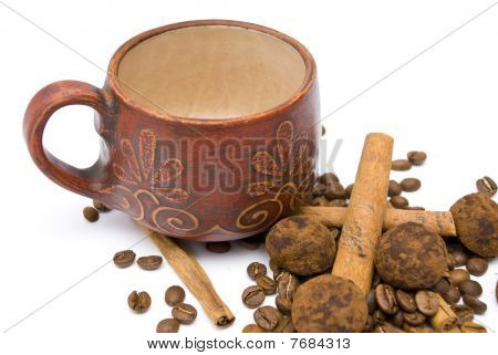 Cup And Coffee Beans On The White Background