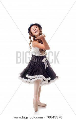 Cute young ballerina sends air kiss to camera