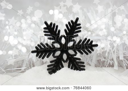 Christmas snowflake decoration nestled in snow