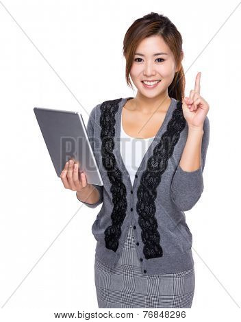 Woman use of digital tablet and finger point up