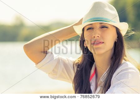 Young Hipster Woman At Sunny Beach. Beautiful Caucasian Girl In Hat At Summer Midday
