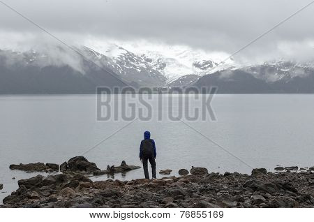 Hiker observing mountain lake