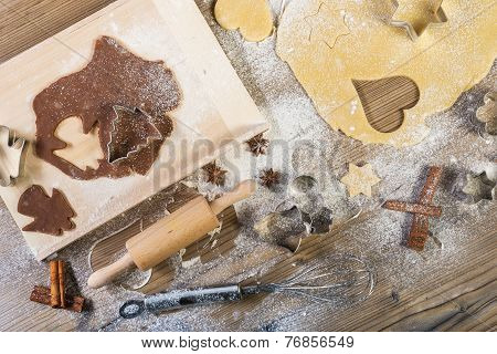 Christmas baking all on the table: pasta cake form meal providing wood spices