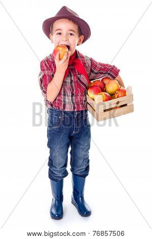 Little Farmer Boy Tasting Fresh Apple