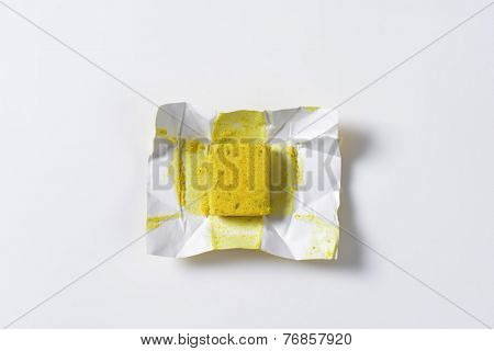 one cube of poultry bouillon with paper wrapper