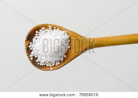 wooden spoon with the whit coarse salt