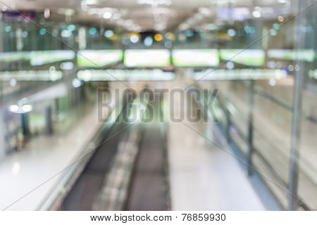 Blurred Image Of Escalator Walk Way In Airport Terminal.