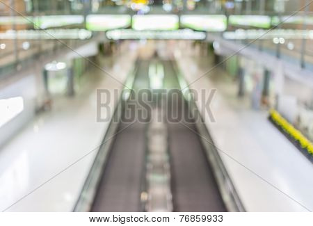 Blurred Background Of Moving Escalator In The Airport Hall.