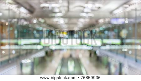 Blurred Background Of Passenger Hall And Moving Escalator In The Airport Terminal.