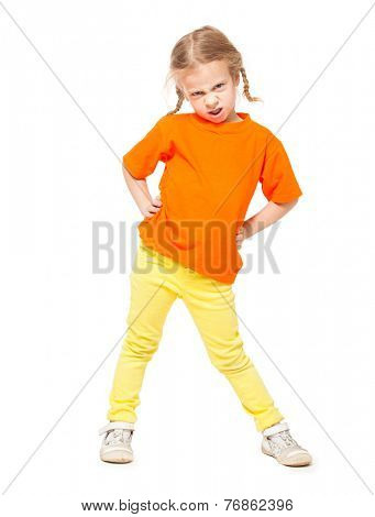 Little angry girl at yellow jeans. Child on white background