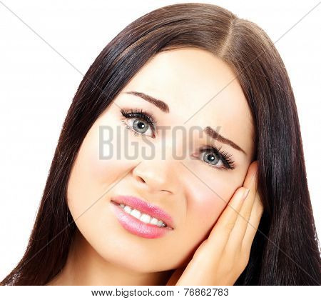 Young woman with a pain in her ear, white background, copyspace