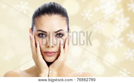 Pretty woman against an abstract background with snowflakes