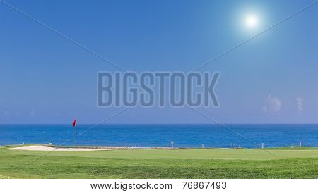 Beautiful Summer View Of A Golf Course. With A Background Of The Sea.