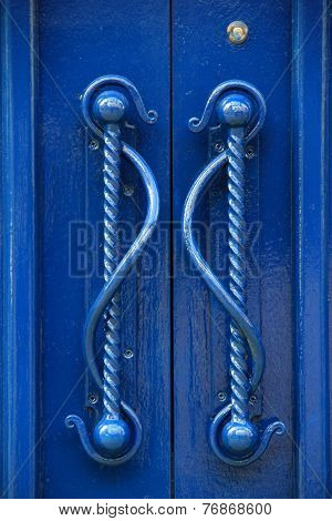 Gorgeous detail in handles of blue doors