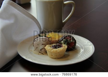 Fruit tarts and chocolate covered berries