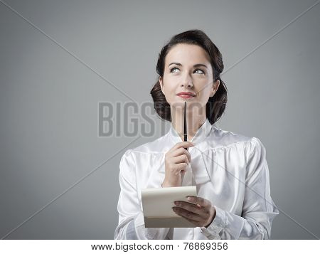 Attractive Vintage Secretary Taking Notes