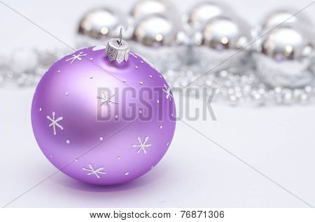Purple And Silver Xmas Decoration. Christmas Card With Pace For