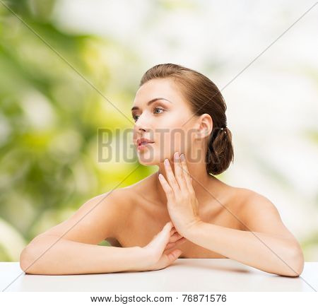 beauty, health and people concept - smiling beautiful woman with clean perfect skin over green background
