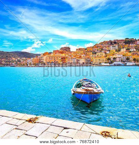 Wooden Small Boat In Porto Santo Stefano Seafront. Argentario, Tuscany, Italy