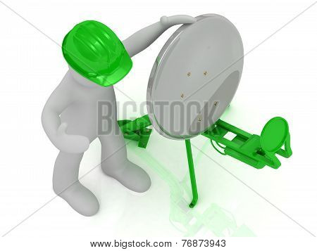 Man In Green Helmet Adjusts The Green Satellite