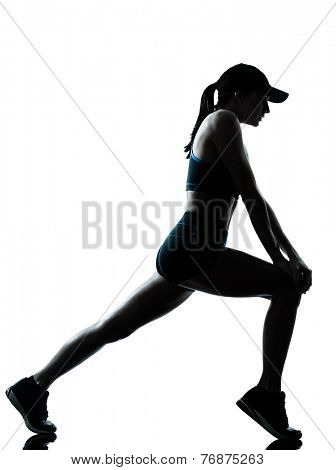 one  woman runner jogger stretching warm up in silhouette studio isolated on white background