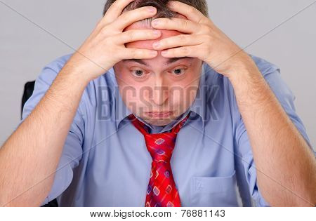 Worried tired businessman