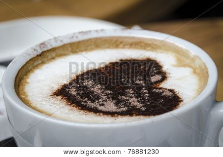 Frothy Top Of A Cup Of Coffee  With Heart Pattern