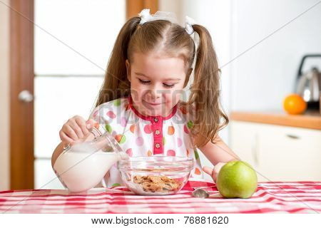 kid preparing corn flakes with milk