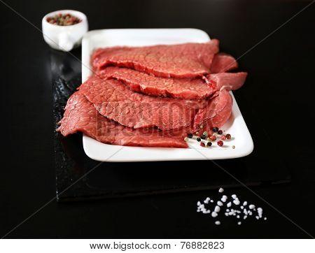 Raw Beef Tenderloin, Salt, Pepper And A Knife