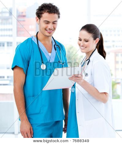 Happy Medical Partners Looking At The Diagnosis