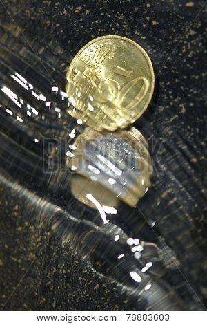 coins under water