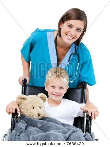 Nice Female Doctor Carrying Adorable Little Boy In The Wheelchair