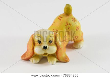 Statuette Of Dog Sitting On White Background