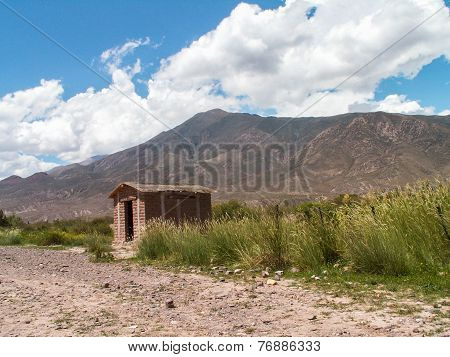 Bolivian Hut By Mountain