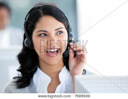 Beautiful Businesswoman Talking With Clients In Front Of Her Computer