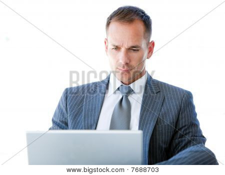 Handsome Businessman Using His Laptop