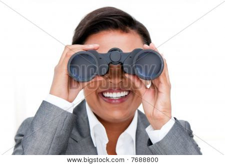 Assertive Businesswoman Looking Through Binoculars