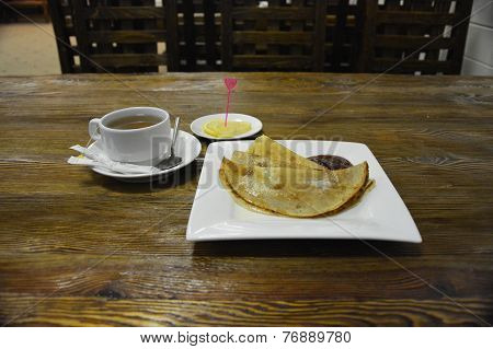 Pancakes with cup of tea