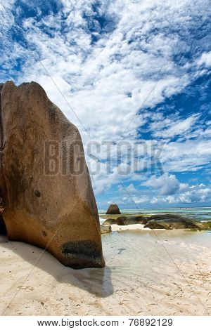 Giant Granite Rocks at Anse Source d'Argent Lagoon in La Digue Island, Seychelles. Captured on Blue and White Clouds Above.