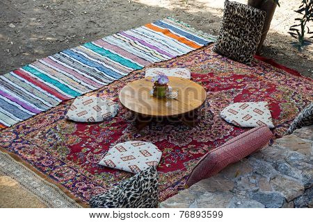 Istambul - Carpet, pillows and table  Inside an Turkish cafe